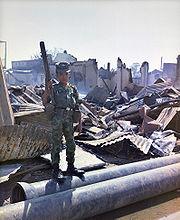 12 year old ARVN soldier with M-79 grenade launcher, Tan Son Nhut, 1968 (Vietnam War).