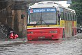 Vietnamese bus on a flooded street.jpg