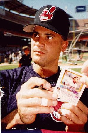 Chief Wahoo - Former Cleveland Indians player Venezuelan Omar Vizquel wearing a Chief Wahoo baseball cap.