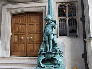 William Silver Frith - One of the pair of ornamental lamppost-sculptures at the portico front entrance of Two Temple Place, designed by Frith.