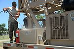 Well drillers clean equipment 150808-F-LP903-0558.jpg