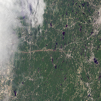 2011 New England tornado outbreak - A satellite view of the tornado's path. The track can be seen as a brown streak across the center of the image; part of the track, including Springfield, is obscured by clouds.