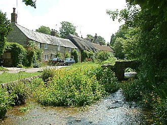 River Caul Bourne - Winkle Street (also known as Barrington Row) in Calbourne, with the Caul Bourne running in front of the houses.