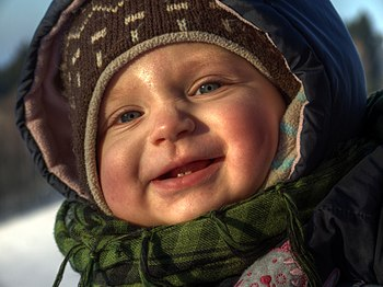 English: 10-months-old baby during winter stro...