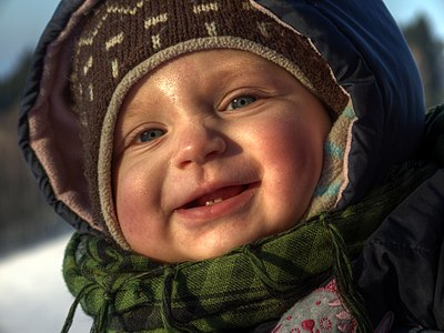 Winter portrait of 10-months-old baby