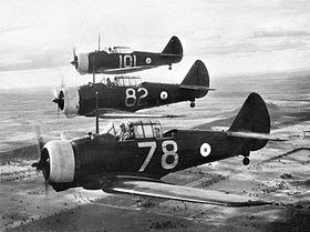 Three single-engined military monoplanes in flight