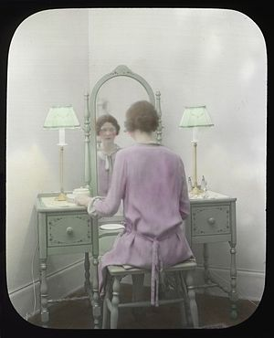 English: Woman at mirror, circa 1930s Item 780...