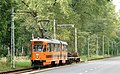 Works tram towing scrapped pointwork from Alfred to Katowice, 10 September 2011.jpg