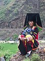 Yi woman in traditional dressing.jpg