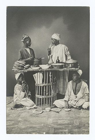 Francis Frith - Four men and a table of food, Egypt