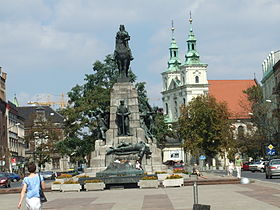 Jan Matejko Square in central Kleparz with Grunwald Monument in front of St. Florian Church and Academy of Fine Arts to the left