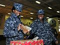 111220-N-KM939-016 - CPO Mattie Hackney gives a sailor cookies during an event sponsored by the USO.jpg