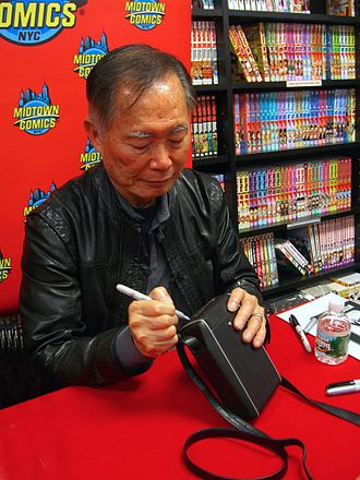 Tricorder - Actor George Takei autographing a tricorder at Midtown Comics in Manhattan.