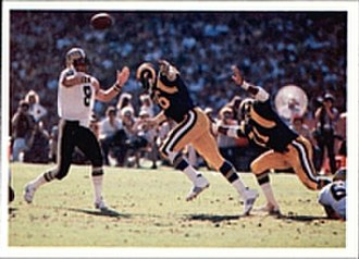 Archie Manning - Manning (left) attempting a pass for the Saints against the L.A. Rams in 1980.