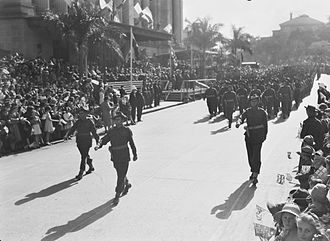 2/9th Battalion (Australia) - Members of the 2/9th march past Brisbane City Hall, August 1944