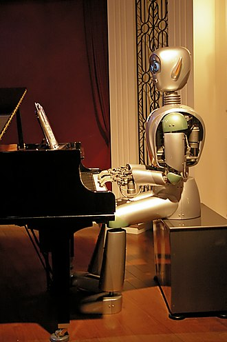 Shanghai Science and Technology Museum - Robot playing the piano in the World of Robots exhibition.