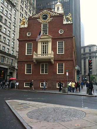 Boston Massacre - View of the Old State House, Boston, Massachusetts, the seat of British colonial government from 1713 to 1776. The Boston Massacre took place in front of the balcony, and the site is now marked by a cobblestone circle in the square (photo 2009).