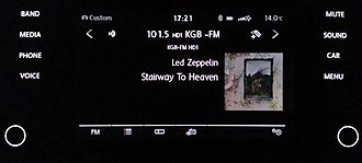 HD Radio - 2017 VW Golf entertainment system displaying song metadata including Artist Experience from San Diego's KGB-FM.