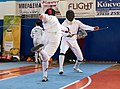 2nd Leonidas Pirgos Fencing Tournament. Flèche by Dimitrios Makris and 4th parry by Ahmed Alhoussain.jpg