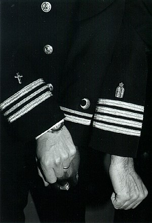 United States Navy Chaplain Corps - The insignia for Christian, Muslim, and Jewish chaplains are shown on the uniforms of three U.S. Navy chaplains.