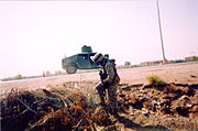 A Marine from 3 24 searches for roadside bombs in the vicinity of Fallujah, Iraq 2004