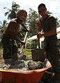 A U.S. Marine and Sailor, both embarked aboard the amphibious assault ship USS Iwo Jima (LHD-7), mix concrete for fence posts in Limon, Costa Rica, Aug. 23, 2010, during Continuing Promise 2010 100823-M-PC721-397.jpg