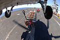 A U.S. Navy Sailor aboard USS Ronald Reagan (CVN 76) prepares to attach a cargo pendant to an SH-60 Seahawk heliocopter during a weapons offload in the South China Sea on April 6, 2007 070406-N-HX866-013.jpg
