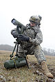 A U.S. Soldier assigned to Bulldog Battery, Fires Squadron, 2nd Cavalry Regiment sets up a collimator for a fire mission with an M777A2 155 mm howitzer during the regiment's mission rehearsal exercise at 130312-A-HE359-089.jpg