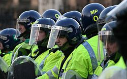 A lot of yellow TSG Police Line Student Protests - Parliament Square, Westminster 2010