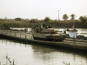 M1 Abrams - Abrams crossing the Euphrates River at Objective Peach on ribbon assault float bridge deployed by the 299th Engineer Company in 2003.
