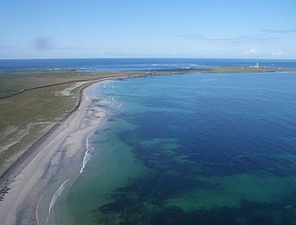 The flat landscapes of North Ronaldsay. According to the Orkneyinga saga Einarr slew his enemy Halfdan on the island. Aerial view of Linklet Bay - geograph.org.uk - 224596.jpg