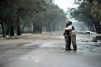 Hurricane Ike - A US-Air Force Staff Sergeant receives a hug from a resident after Hurricane Ike, September 13, 2008.