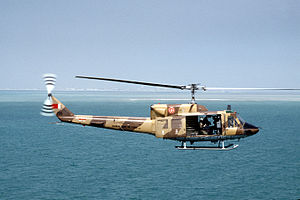 Royal Bahraini Air Force - A Bahrain Air Force Agusta-Bell 212 Twin Huey in flight over the Persian Gulf during a training mission in 1991