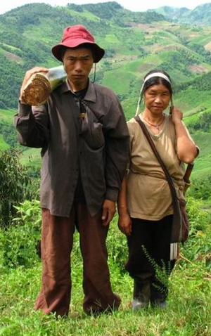 Akha couple in northern Thailand. The husband ...