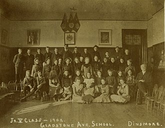 Alexander Muir - Gladstone School and students. Alexander Muir (principal) seated at right. 1902.