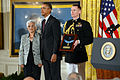 Alice Mendoza, left, accepts the Medal of Honor on behalf of her late husband, U.S. Army Staff Sgt. Manuel V. Mendoza, from President Barack Obama during a ceremony at the White House in Washington, D.C 140318-D-DB155-019.jpg