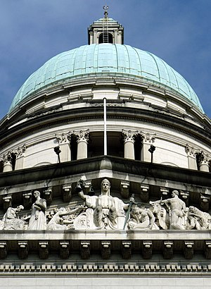 Old Supreme Court Building, Singapore - The allegory of justice is visible below the cupola