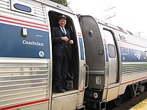 Amtrak Downeaster conductor standing in Amfleet car doorway.jpg