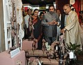 Anand Sharma going round the Exhibition of Handicraft and Handloom Products from West Bengal, in New Delhi on September 05, 2011. The Secretary, Ministry of Textiles, Ms. Rita Menon is also seen.jpg