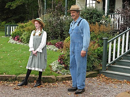 Actors at the Anne of Green Gables Museum on Prince Edward Island, Canada. Since its first publication in 1908, the story of the orphaned Anne, and how the Cuthberts took her in, has been widely popular in the English-speaking world and, later, Japan. Anne of Green Gables.jpg