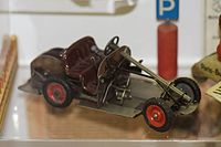 Antique toy wind-up car with mechanism exposed (25599882182).jpg