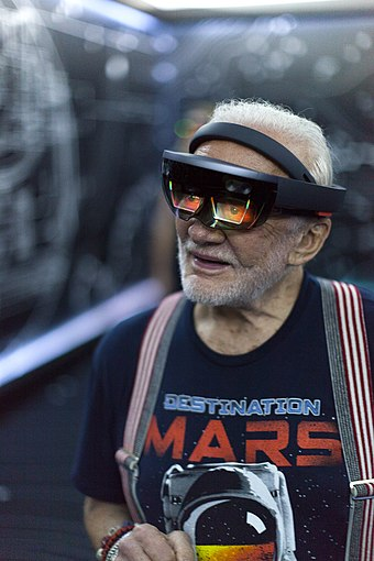 Apollo 11 astronaut Buzz Aldrin using a Microsoft HoloLens mixed reality headset in September 2016 Apollo 11 astronaut Buzz Aldrin tries out Microsoft HoloLens (29794543715).jpg
