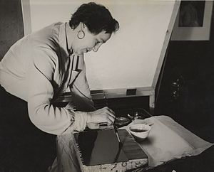 Kyra Markham - Markham working on lithographic stone, c. 1937, from the Archives of American Art