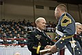 Army Gen. Martin E. Dempsey, chairman of the Joint Chiefs of Staff, congratulates a graduate of the Virginia Military Institute during the school's commencement ceremony in Lexington, Va., May 16, 2014 140515-D-VO565-029a.jpg