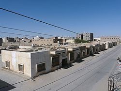 Part of old Ataq city with some modern buildings.
