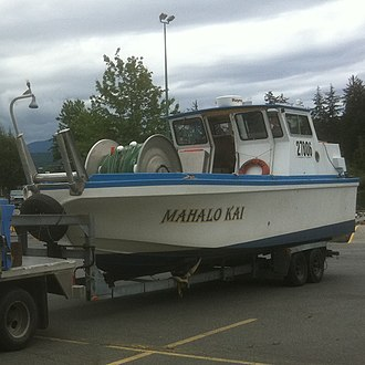 Gillnetting - Contemporary Canadian commercial salmon bowpicker on trailer.  Gillnet is evident on the metal drum in the bow of the boat.