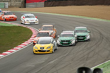 Previous generation BTC Touring cars racing at Brands Hatch, April 2006 BTCC Brands06 PaddockHill.jpg