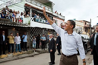 Favela - Former U.S. president Barack Obama visiting Rio's Cidade de Deus (City of God) favela. This favela started out as public housing built on marshy flatlands in the city's western suburbs.