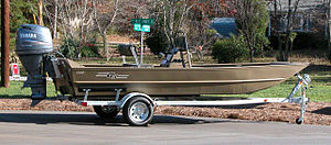 Bass boat, aluminum, center console, on trailer
