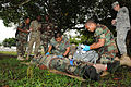 Belize Defence Force combat medics, Cpl. Paul Shal and Lance Cpl. Leon Lopez treat a mock casualty, in front of Belize Defence Force and U.S. Army observers and instructors, during a medical exchange, at 100830-A-CL600-050.jpg